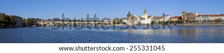 PRAGUE, CZECH REPUBLIC-OCTOBER 3, 2013 : Panorama of the Charles Bridge and Novotny  Lavka at the Old City, the center of foreigners and tourists of the world - stock photo