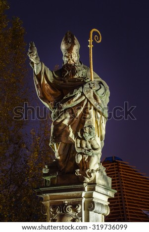 PRAGUE, CZECH REPUBLIC - OCTOBER 8, 2014: Statue of Blessed St. Augustine tramples heretical books on Charles bridge, Prague, Czech republic. - stock photo
