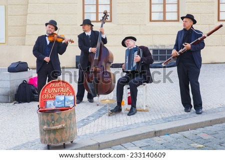 Prague, Czech Republic - October 6, 2014: Street musicians (Buskers) with violin, clarinet, viola, accordion of the Funfair orchestra on the Old Town. - stock photo