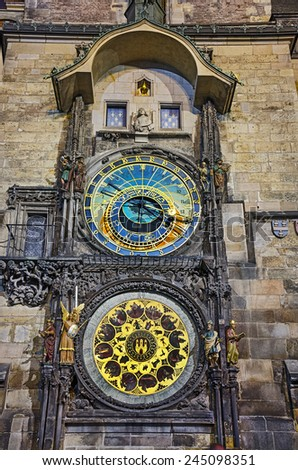PRAGUE, CZECH REPUBLIC - SEP 03: Prague Astronomical Clock has four moving components: the zodiacal ring, an outer rotating ring, an icon representing the Sun, and an icon representing the Moon. - stock photo