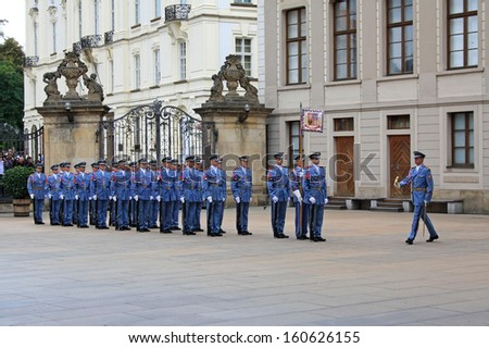 PRAGUE, CZECH REPUBLIC - SEPTEMBER 15, 2013: Changing of the Guards ceremony on September 15, 2013 in Prague. It takes place in Prague Castle at 12.00 daily and attracts many tourists. - stock photo