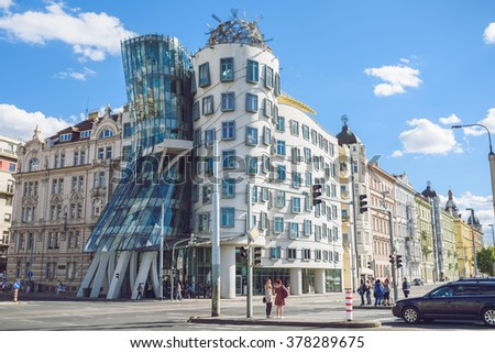 PRAGUE, CZECH REPUBLIC - SEPTEMBER 19, 2015: Dancing house by Frank Gehry in Prague on September 19. Dancing house or Fred and Ginger building in downtown Prague, Czech Republic. - stock photo