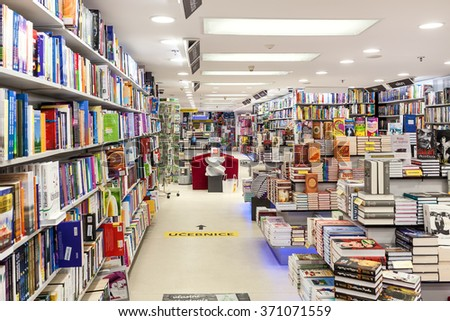 PRAGUE, CZECH REPUBLIC - SEPTEMBER 23, 2015: Interior of Dobrovsky bookstore located on Wenceslas Square - one of largest networks specializing in books sales with 24 stores throughout the country. - stock photo