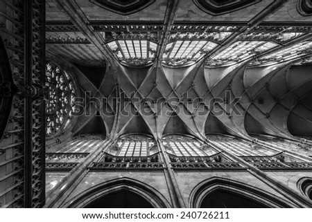 PRAGUE, CZECH REPUBLIC - SEPTEMBER 19, 2014: Interior of the Cathedral of Saints Vitus, Wenceslaus and Adalbert. The cathedral is an excellent example of Gothic architecture. Black and white