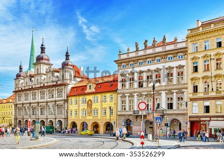 PRAGUE, CZECH REPUBLIC-SEPTEMBER 5, 2015:Main square of Prague's Mala Strana(Lesser Town of Prague).St. Nicholas Church and the adjacent building complex divides the square in an upper and lower part. - stock photo