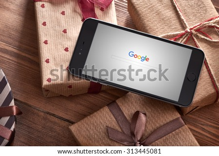 PRAGUE, CZECH REPUBLIC - SEPTEMBER 1, 2015: New Google logo on their search page immediately at the release date is displayed on black iphone 6 plus. With clipping path. - stock photo