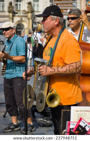 PRAGUE, CZECH REPUBLIC - SEPTEMBER 18, 2014: Performance of street musicians performing music in the style of jazz at the Old Town Square.