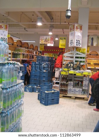 PRAGUE, CZECH REPUBLIC - SEPTEMBER 14: Supermarket Employees remove bottles following the ban of hard spirits because of the bootleg (Methanol) scandal, on September 14, 2012 in Prague, Czech Republic - stock photo