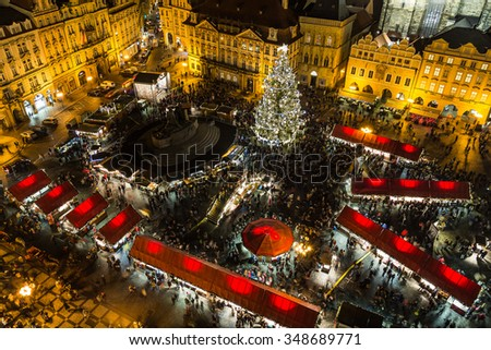 PRAGUE, CZECH REPUBLIC - 6TH DECEMBER 2015: A high view of the Christmas Market in Prague showing the market stalls, people and the tree. - stock photo