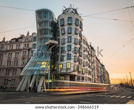 PRAGUE, CZECH REPUBLIC - 5TH DECEMBER 2015: The outside of the Dancing House (Fred and Ginder) building during the day. The blur of traffic can be seen going past. - stock photo