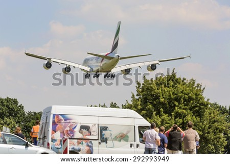 PRAGUE , CZECH REPUBLUC - 1 JULY 2015: An Emirates Airbus A380 Superjumbo landing in PRAGUE. The Airbus A380 is the world's largest passenger airliner. Emirates is an airline based in Dubai. - stock photo