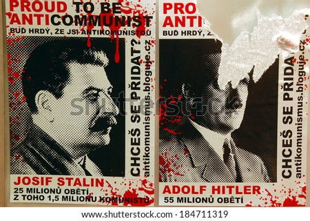 PRAGUE, CZECHIA - AUGUST 04, 2008: Photo of a worn out leaflet showing portraits of Lenin and Stalin with indication of a number of people murdered by these two dictators on the street pole in Prague - stock photo