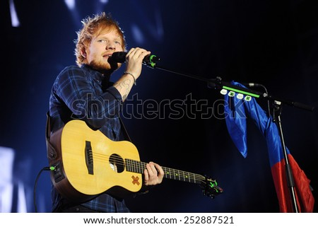 PRAGUE - FEBRUARY 12: British singer Ed Sheeran during his performance in Prague, Czech republic, February 12, 2015. - stock photo