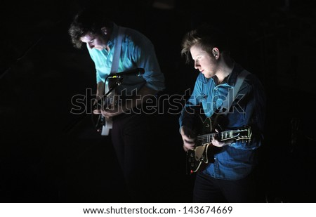 PRAGUE - FEBRUARY 26: Sam Halliday (left) and Alex Trimble (right) of Two Door Cinema Club during performance in Prague, February 26, 2013