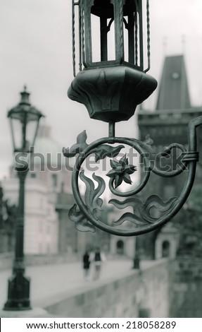 Prague, fragment of a vintage street light on Charles Bridge - stock photo