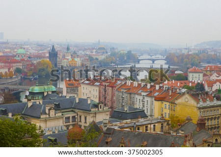 Prague in autumn morning, view over the roofs.