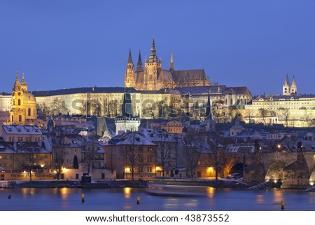 prague in winter - charles bridge and hradcany castle at dusk - stock photo