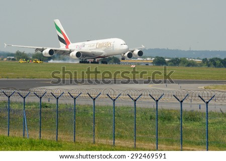 PRAGUE - JULY 1: Emirates Airbus A380, the world's largest passenger airliner, landing to Vaclav Havel Airport Prague, July 1, 2015. - stock photo