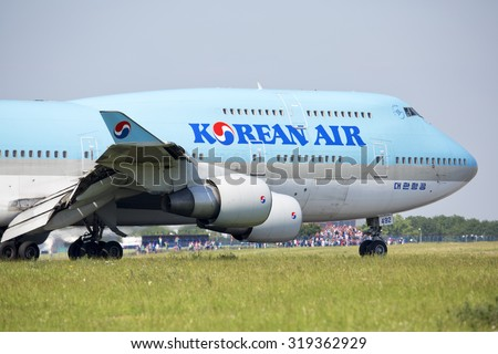 PRAGUE - July 1, 2015: Korean Air Boeing 747-400 at  Vaclav Havel Airport Prague on July 1, 2015. Korean air is the flag carrier airline of South Korea. - stock photo