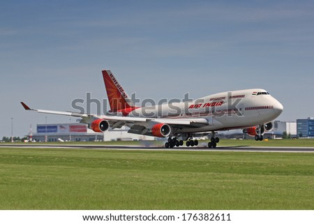 PRAGUE - JUNE 6: An Air India Boeing 747 landing on June 6, 2010 in Prague. Air India is the flag carrier airline of India with 101 planes in operation. - stock photo