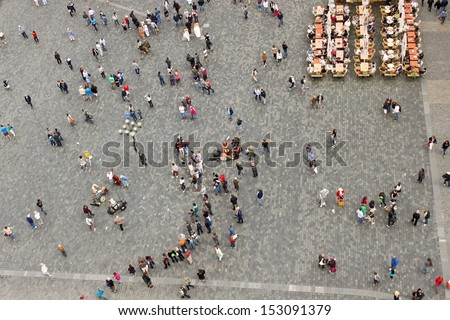 PRAGUE - JUNE 30: People listening to the street band on one of the most popular places in Prague - the Old Town Square on June 30, 2013. - stock photo