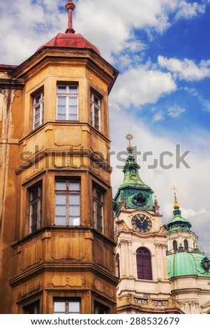 Prague Little Quarter architecture details with St. Nicholas Church in the background - stock photo