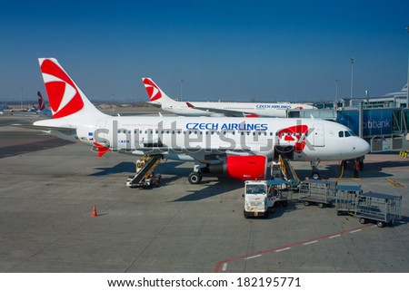 PRAGUE - MARCH 10: A319 Czech Airlines stand at terminal of PRG in Prague, Czech Republic on March 10, 2014. CSA Czech Airlines is the national flag carrier airline of Czech republic - stock photo