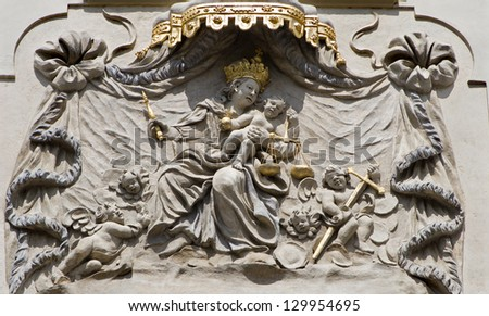 PRAGUE - MARCH 8: Baroque relief of Madonna from facade of old house from 17. cent. on March 8, 2004 in Prauge.