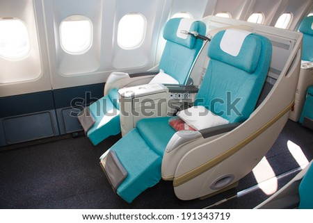 PRAGUE - MARCH 10: Czech Airlines A330 seats in business class prepare for flight to Seoult on March 10,2014. CSA Czech Airlines is flag carrier of Czech republic - stock photo