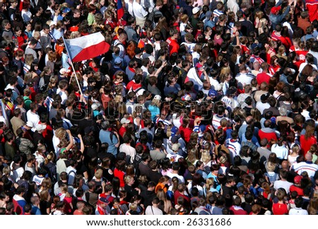 PRAGUE - MAY 25 : Huge crowd celebrate victory at a Czech ice hockey competition in Prague, Czech Republic, on May 25, 2008. - stock photo