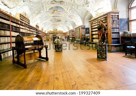 PRAGUE - MAY 17: Old books on the shelves of the library in the beautiful building of Strahov monastery on May 17, 2014 in Czech Republic. Library keeps 200 000 prints, from the 16th & 18th century  - stock photo