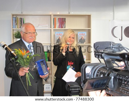 PRAGUE - MAY 13: President of Czech republic Vaclav Klaus with prize for his bestseller book of year 2010, which won at Book World Prague 2011, international literary festival, May 13, 2011, Prague - stock photo