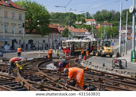 PRAGUE, MAY 14, 2016: Reconstruction of rail lines in Klarov quarter and on the Manes Bridge in Prague. Trams, buses and metro lines transport daily millions of citizens and tourists. Czech Republic. - stock photo