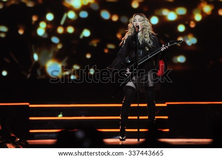 PRAGUE - NOVEMBER 7: Famous pop singer Madonna during her performance in Prague, Czech republic, November 7, 2015. - stock photo