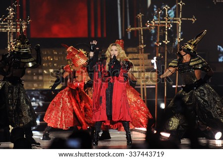 PRAGUE - NOVEMBER 7: Famous pop singer Madonna (in the middle) during her performance in Prague, Czech republic, November 7, 2015. - stock photo