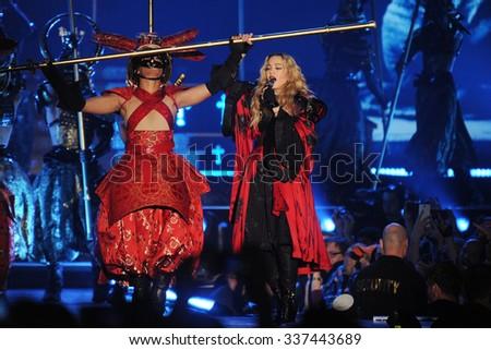 PRAGUE - NOVEMBER 7: Famous pop singer Madonna (right) during her performance in Prague, Czech republic, November 7, 2015. - stock photo