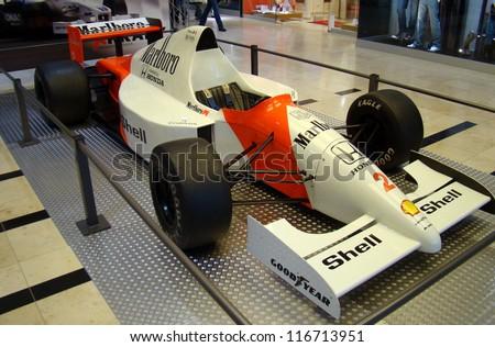 PRAGUE - OCTOBER 16: Exhibition of historic Formula 1 cars in Prague, Czech rep.,on October 16, 2009. (McLaren Honda MP4/5, 1989) Ayrton Senna's and Alain Prost's famous formula. - stock photo