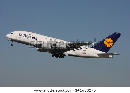 PRAGUE - OCTOBER 02: Lufthansa Airbus A380 airliner takes off from PRG Airport on October 02, 2011 in Prague, Czech Republic. The A380 is currently the largest passenger airliner. - stock photo