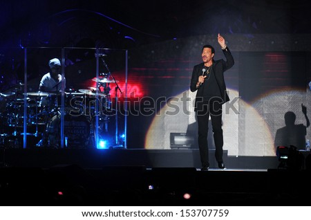 PRAGUE - OCTOBER 20: US singer Lionel Richie (right) during his performance in Prague, Czech republic, October 20, 2012 - stock photo