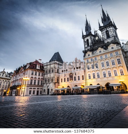 Prague, Old Town Hall (15th Century), Town Square and Church of our Lady Tyn (1365) at dawn. - stock photo