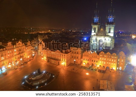 Prague Old Town main square and Gothic church illuminated during autumn night, Czech Republic - stock photo