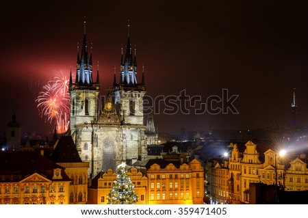 Prague old town with fireworks behind Church of Our Lady before Tyn  in the night with old building. Capital city of Czech Republic and one of the most famous tourist place in Europe. - stock photo