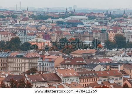 Prague rooftops, beautiful aerial view of Czech baroque architecture with red roofs.