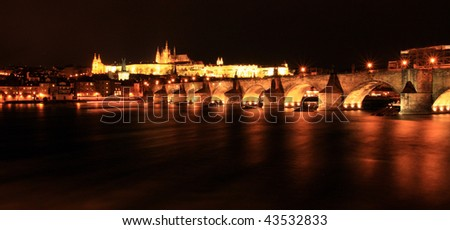 Prague's castle and Charles bridge at night