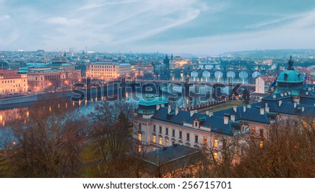 Prague scenery over river  and bridges at dusk - stock photo