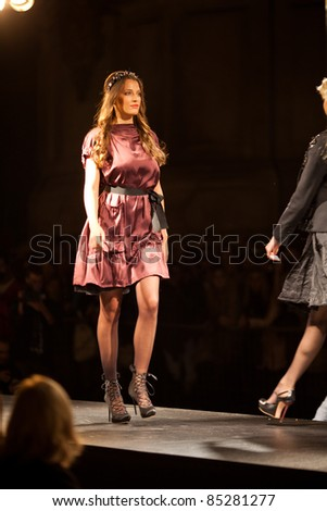PRAGUE-SEPTEMBER 24: A model walks the runway during the 2011 autumn/winter Nina Ricci Paris Collection by Obsession during the Prague Fashion Weekend on September 24, 2011 in Prague, Czech Republic.