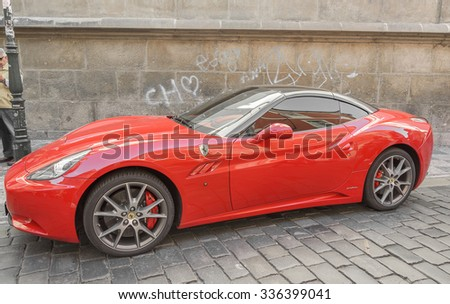 PRAGUE - SEPTEMBER 25: Ferrari F12 Berlinetta in Prague on September 25, 2015. According to the manufacturer's acceleration to 200 km.h is only 8.5 seconds. - stock photo