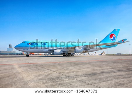 PRAGUE - SEPTEMBER 6: Korean Air Boeing 747 goes to the parking stand in Vaclav Havel Prague Airport on September 6, 2013. Korean Air is a private national airline, the largest in South Korea. - stock photo