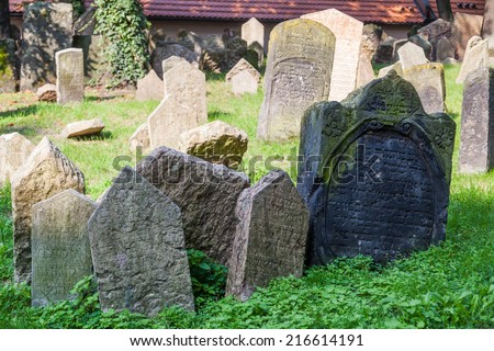 PRAGUE - SEPTEMBER 04: tombstones on Old Jewish Cemetery in the Jewish Quarter on September 04, 2014 in Prague. It has been estimated that there are about 12000 tombstones presently visible - stock photo
