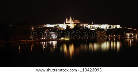 Prague Skyline, include Charles Bridge and Prague Castle, seen from  Legion Bridge at night - stock photo